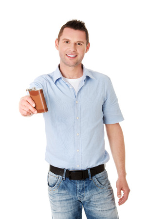 hip flask: Young confident man with hip flask