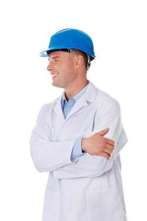 technologist: Man in a lab coat and helmet, engineer, teacher or chemical looking on copy space Stock Photo