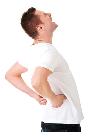 agony: Young man in agony with back pain Stock Photo