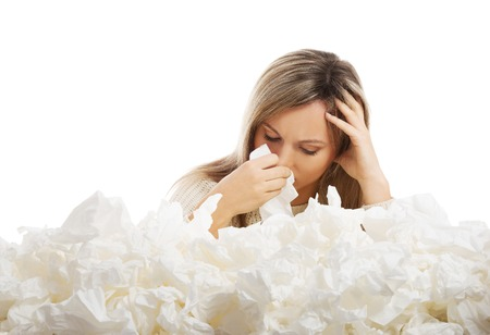 sore eye: Young woman in lot of tissues around, ill Stock Photo