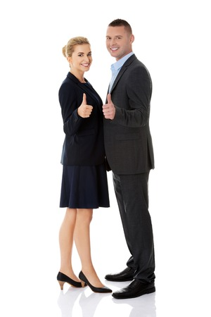 Business couple showing thumbs up. photo