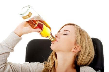 drinking alcohol: Yound beautiful woman in depression, drinking alcohol