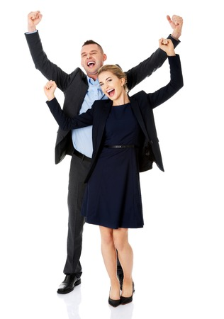 Victorious business couple with hands up. photo