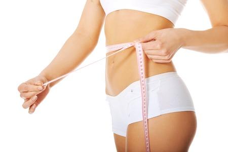 Woman measuring perfect shape of beautiful body. photo