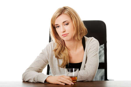 irresponsible: Yound beautiful woman in depression, drinking alcohol