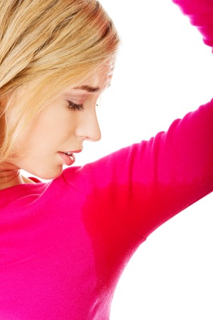 badly: Woman sweating very badly have wet armpit