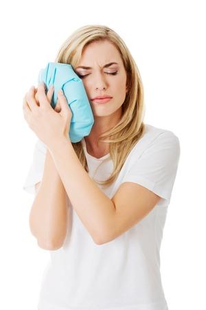 heaving: Woman heaving tooth ache, holding ice bag Stock Photo