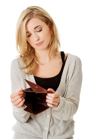 Young caucasian woman with empty wallet - broke photo