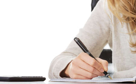 Escrita, mão escreve com uma caneta em um caderno Imagens