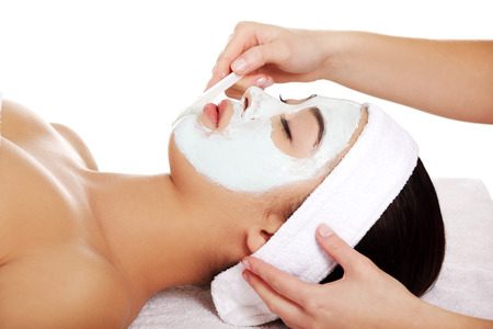 Relaxed woman with  a deep cleansing nourishing face mask applied to her face, beauty and skincare concept photo