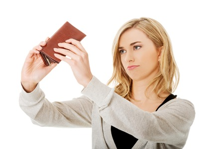 empty wallet: Young caucasian woman with empty wallet - broke