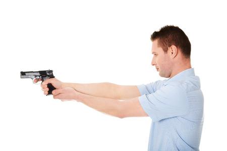Man holding handgun and aiming photo
