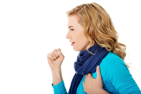 grippe: Young woman has a flu. Coughing. Stock Photo