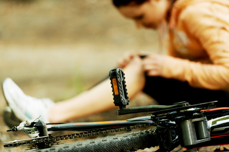 Wounded woman was falled off bicyle. Stock Photo