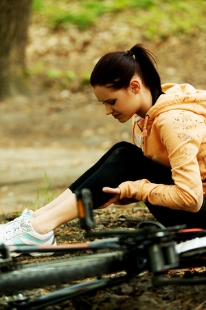 misadventure: Wounded woman was falled off bicyle. Stock Photo