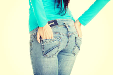Fit female butt in jeans, isolated photo