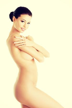 desnudo de mujer: Sexy mujer desnuda aisladas sobre fondo blanco Foto de archivo