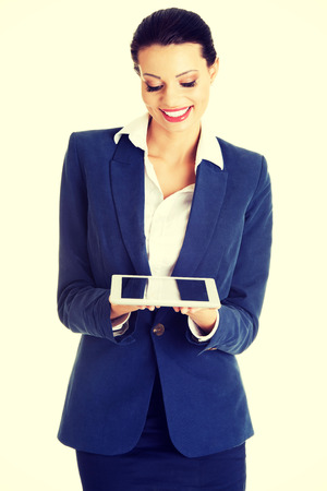 Attractive business woman using digital tablet computer PC, isolated on white background. photo