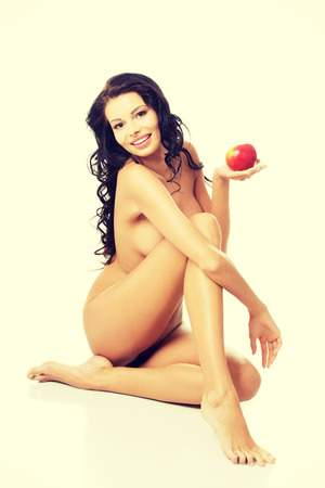 Happy fit nude woman with apple, isolated on white. Healthy life, siet and nutrition concept.