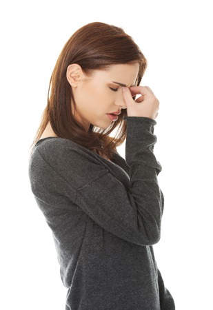 Young woman with sinus pressure pain photo