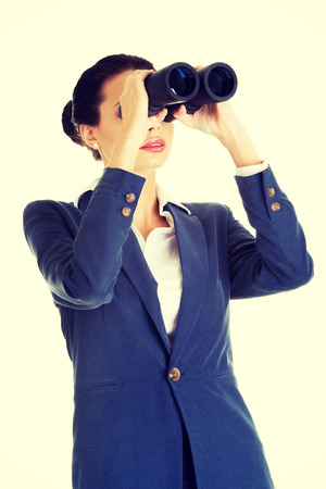 oportunity: Businesswoman with binoculars searching for business oportunity in the future. Isolated on white background.