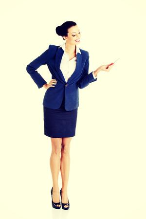 Portrait of beautiful businesswoman with big conceptual car keys photo