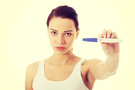 Woman worrying because of the pregnancy test result. photo