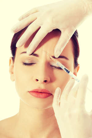 Cosmetic botox injection in the female face photo