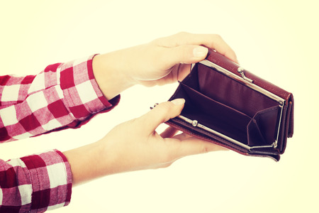 Woman showing her empty wallet photo