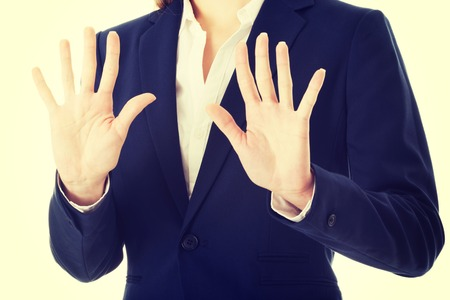disclaim: Business woman showing stop gesture.