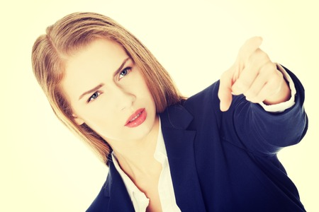 Beautiful business woman is showing warning sign. Over white. Stock Photo