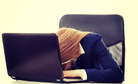 tired woman: Sleeping, tired business woman at call center by the laptop. Isolated  on white.