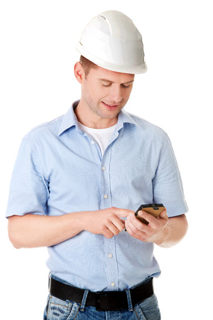 Contractor in hardhat using his cell phone. photo