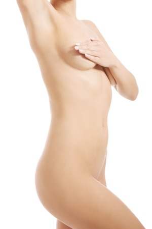 naked breast: Young woman examining her breast