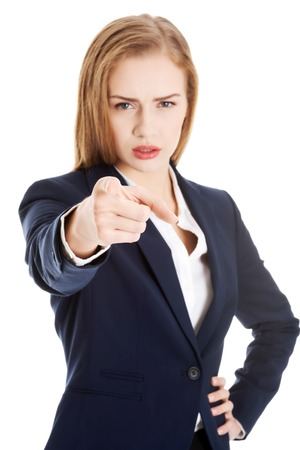 Blonde businesswoman pointing on you photo