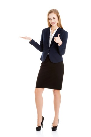 Blonde businesswoman inviting to an office photo