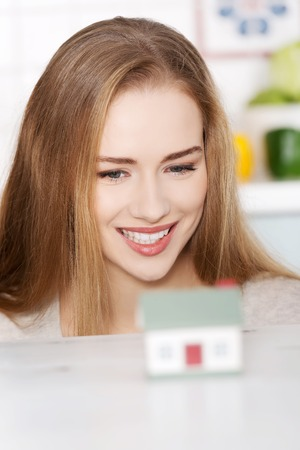 household insurance: Young woman buying new house