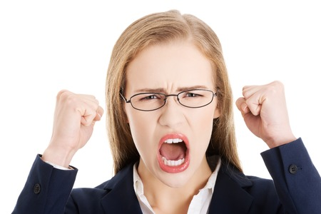 Angry young blonde businesswoman shouting photo