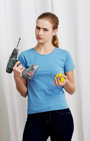 Young businesswoman making silent gesture photo