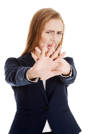 Young businesswoman trying to protect herself photo