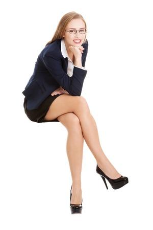Beautiful young blonde businesswoman sitting Stock Photo