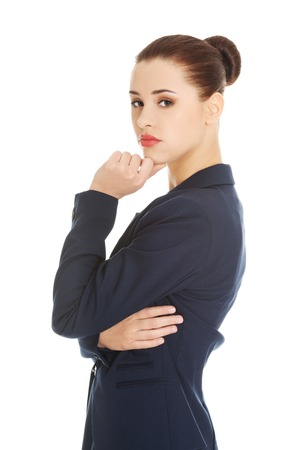 hesitations: Thinking businesswoman standing pensive contemplating.