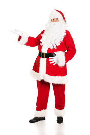full length: Full length Santa Claus with a welcome gesture.