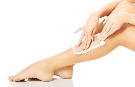 waxed: Cerca de la mujer piernas con cera.