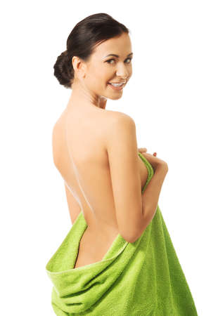Back view woman wrapped in towel. Stock Photo