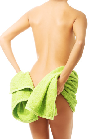 bum: Back view woman covering her bum with a towel. Stock Photo