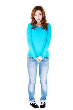 shy woman: Full length shy woman standing.