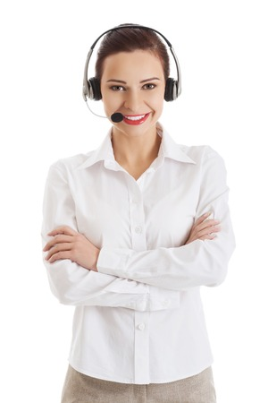 Smiling call center woman with folded arms. photo