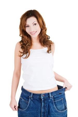 erfolgreiche frau: Erfolgreiche Frau in den zu gro�en Jeans.