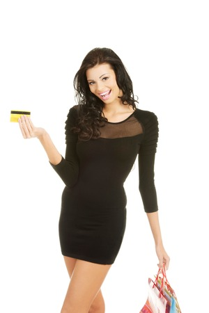 Woman with shopping bags and credit card. photo